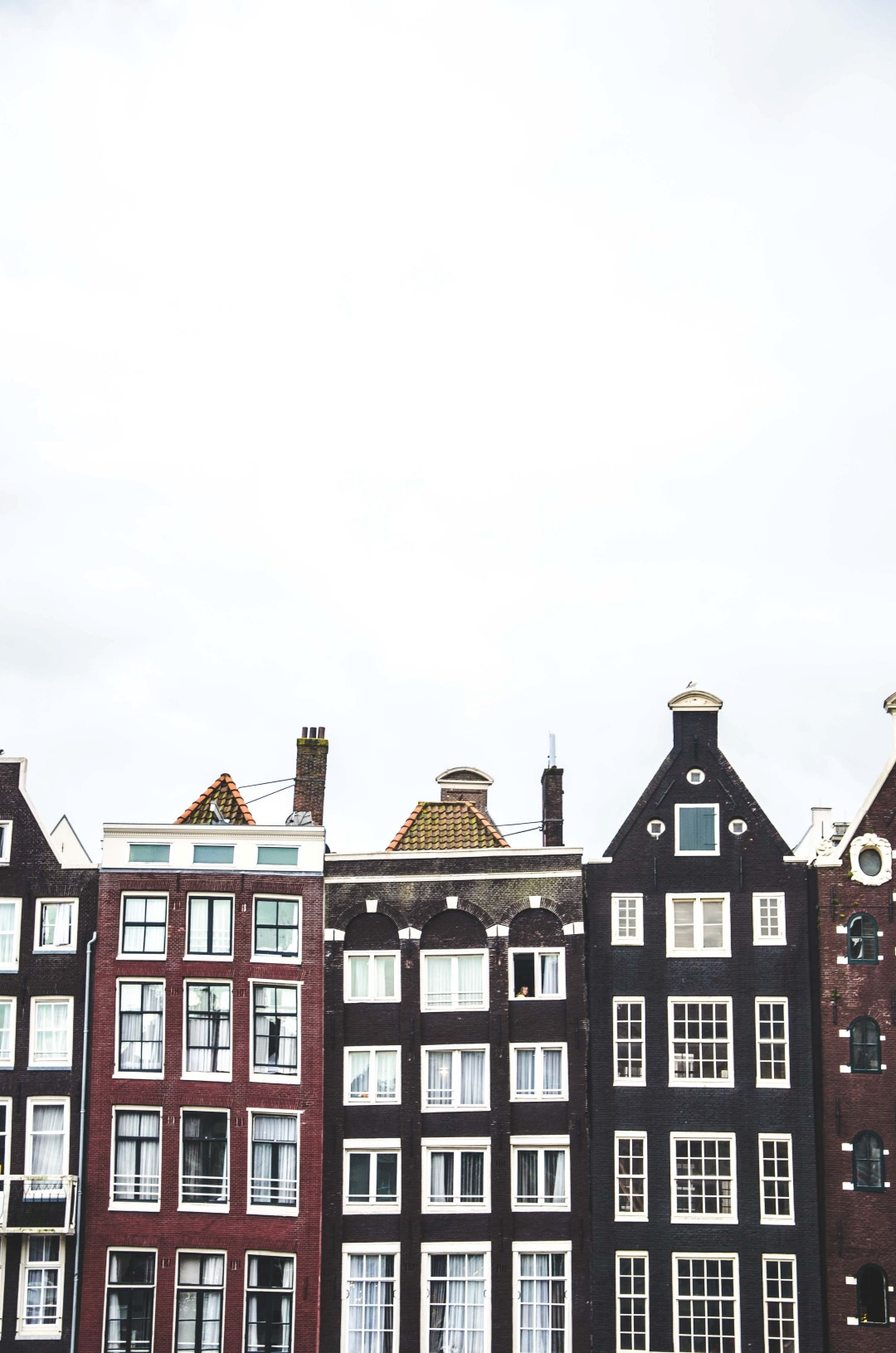 What is interesting about Amsterdam - A city of surprises, canals, and amazing architecture?