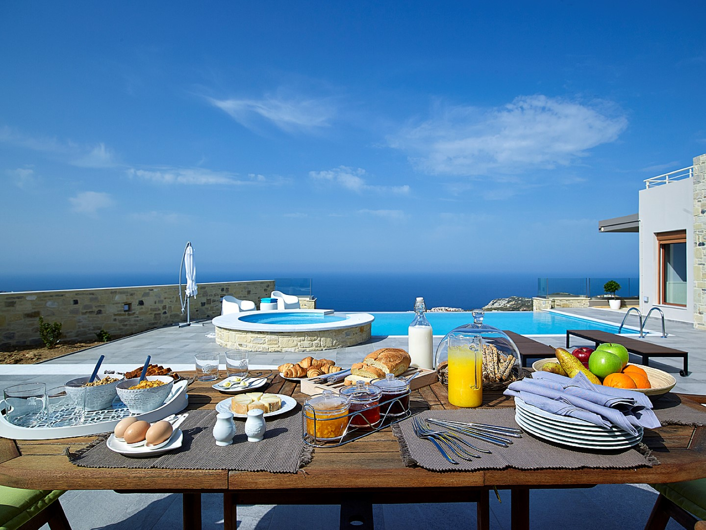 "Cretan breakfast overlooking the Aegean Sea? That's a totally ""yes"" by us!"