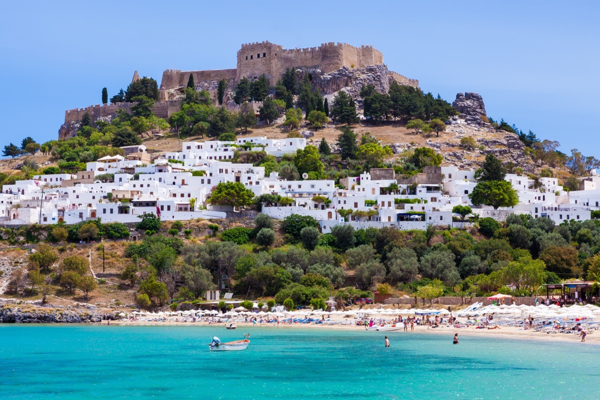 Lindos with the castle above on the Greek Island of Rhodes   Travel By Interest