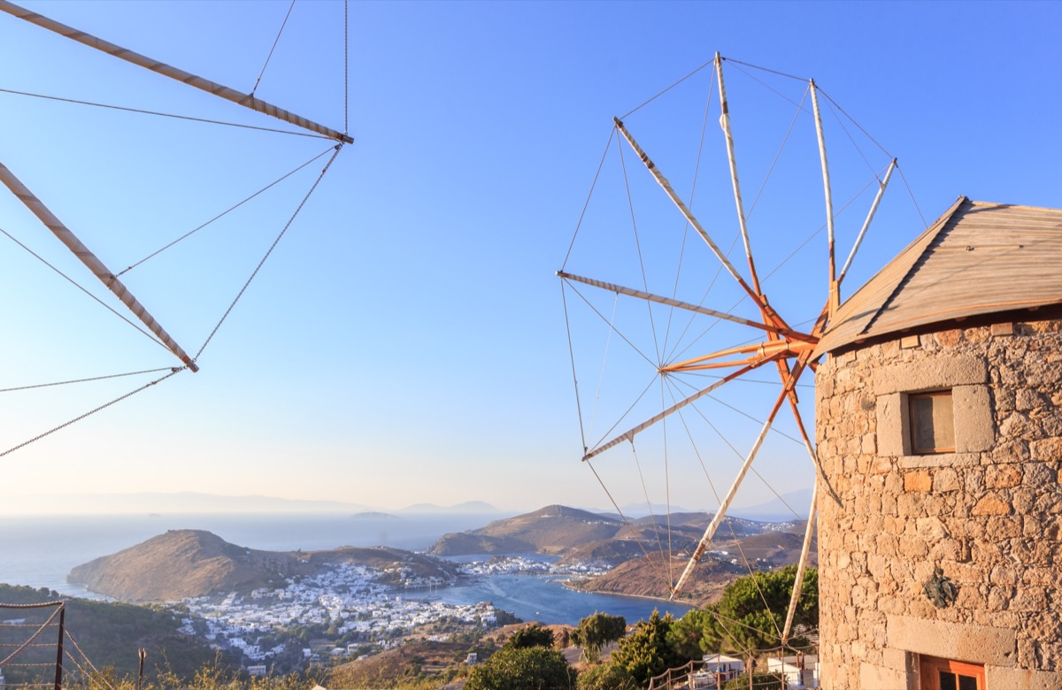 Windmills in the setting sun on the island of Patmos   Travel By Interest